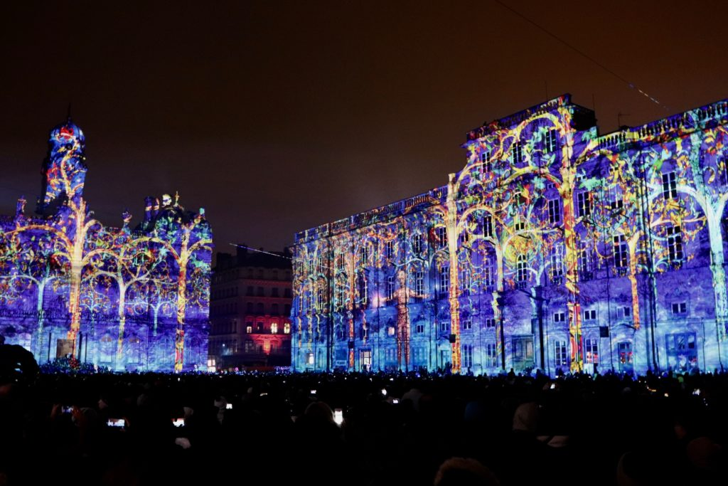 Colorful projections of lights on the facades of the Town Hall and the fine Arts Museum. (Place des Terreaux.)